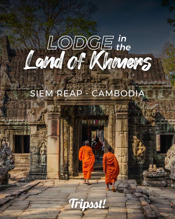 Photoshoot of a gate in Cambodia, with two monks