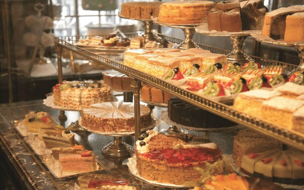 A group of cakes and other desserts