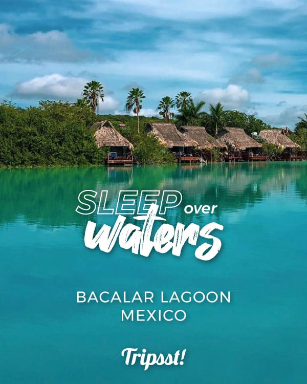 Wood cabins over crystal-clear waters of the Lagoon