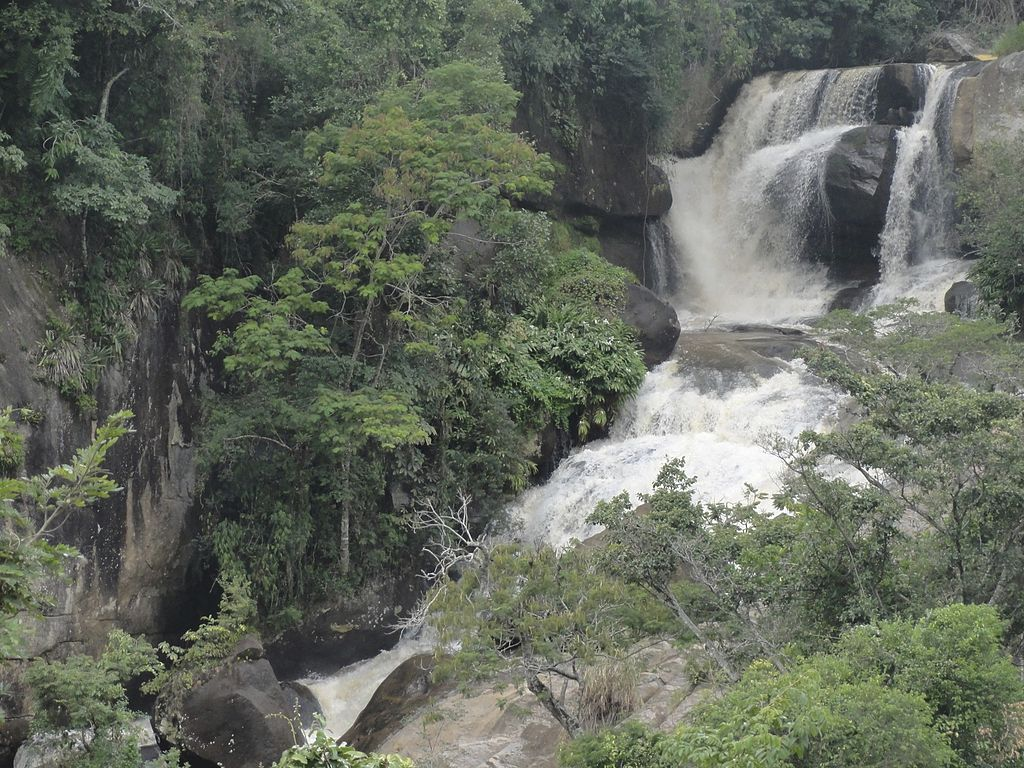 Waters drop into cascading falls in a forested valley near Gonçalves