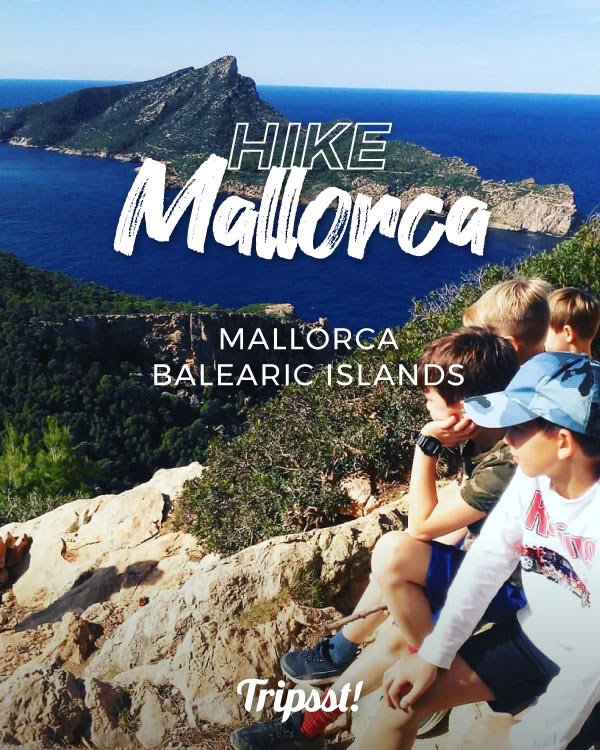 Children in a mountain with an incredible view of the blue sea of Majorca