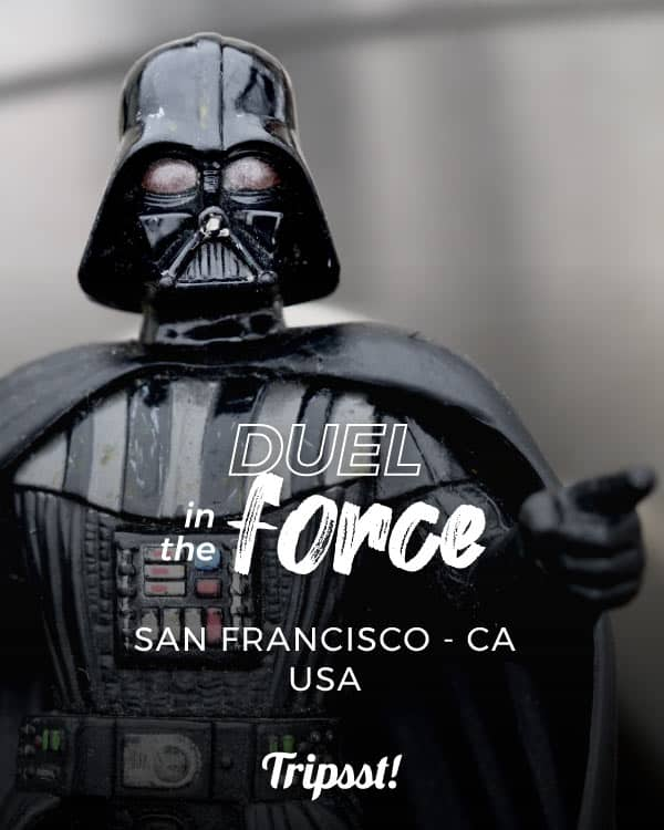 A figurine of Darth Vader with a gray background