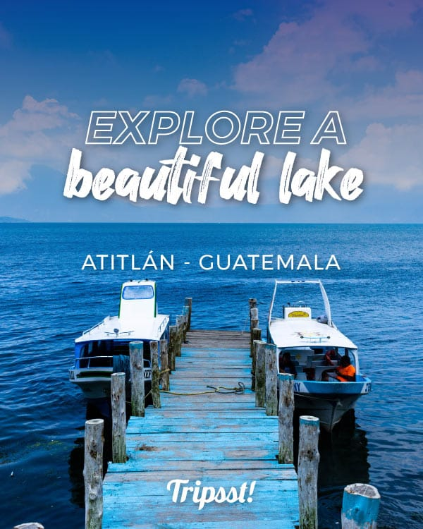 Wooden dock and boats jettying into the waters of Lake Atitlán