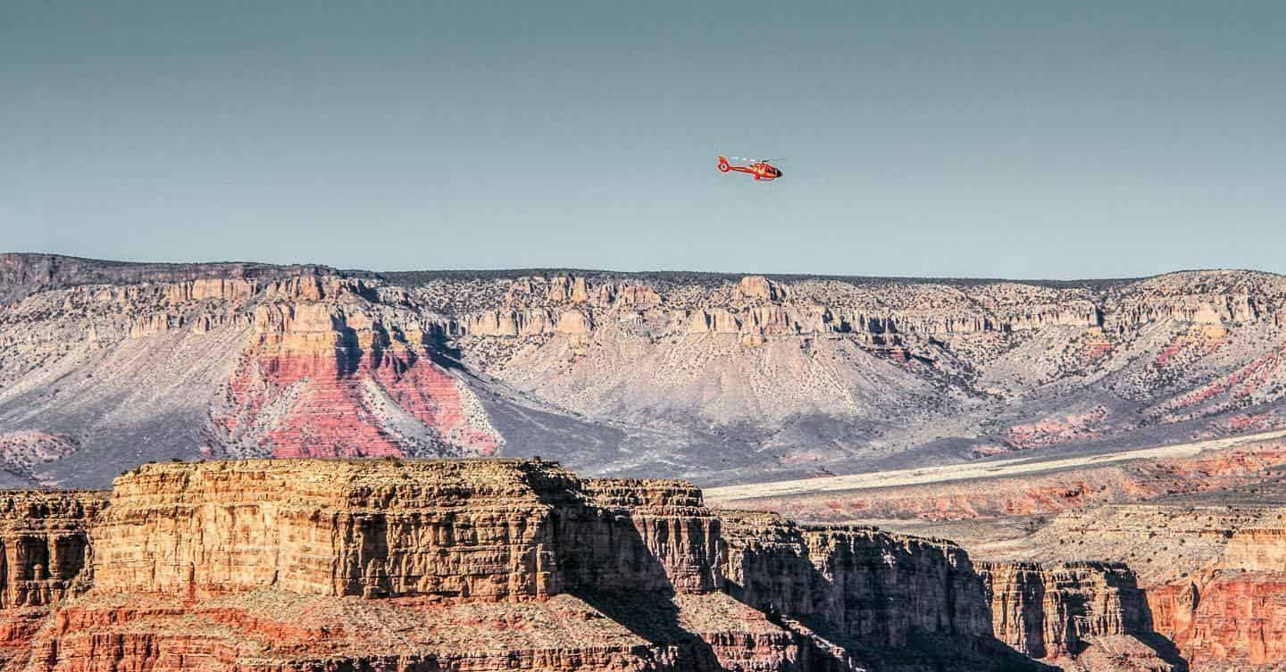 A red chopper flies over the Grand Canyon in northern Arizona