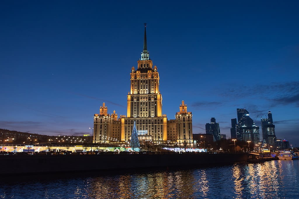 Nighttime view of the Hotel Ukraina from the Moskva River