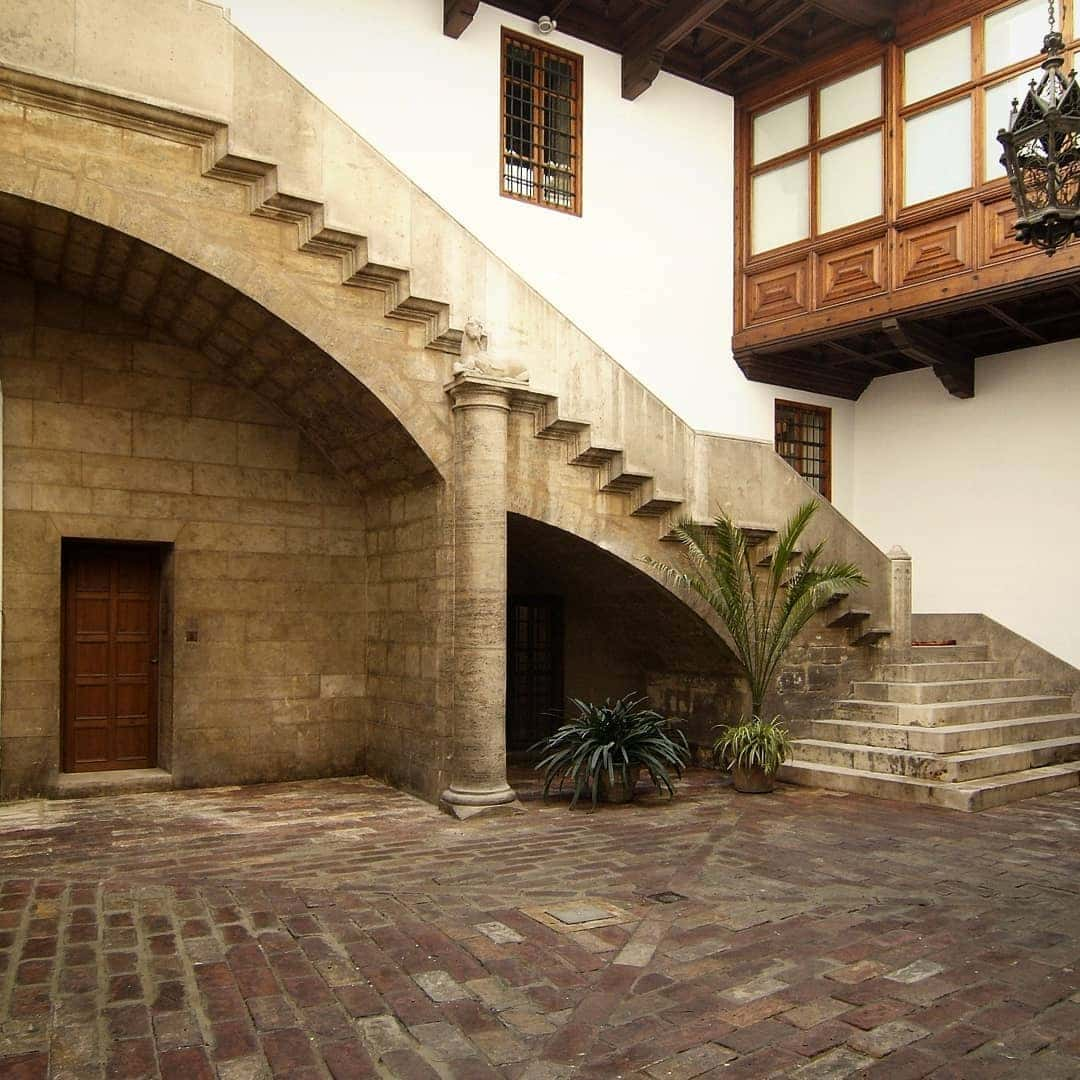 View of the courtyard and staircase of a Gothic palace in Valencia