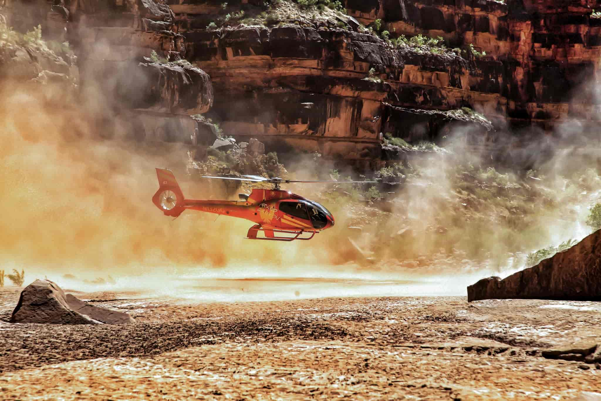 Helicopter lands in the bottom of a rocky canyon