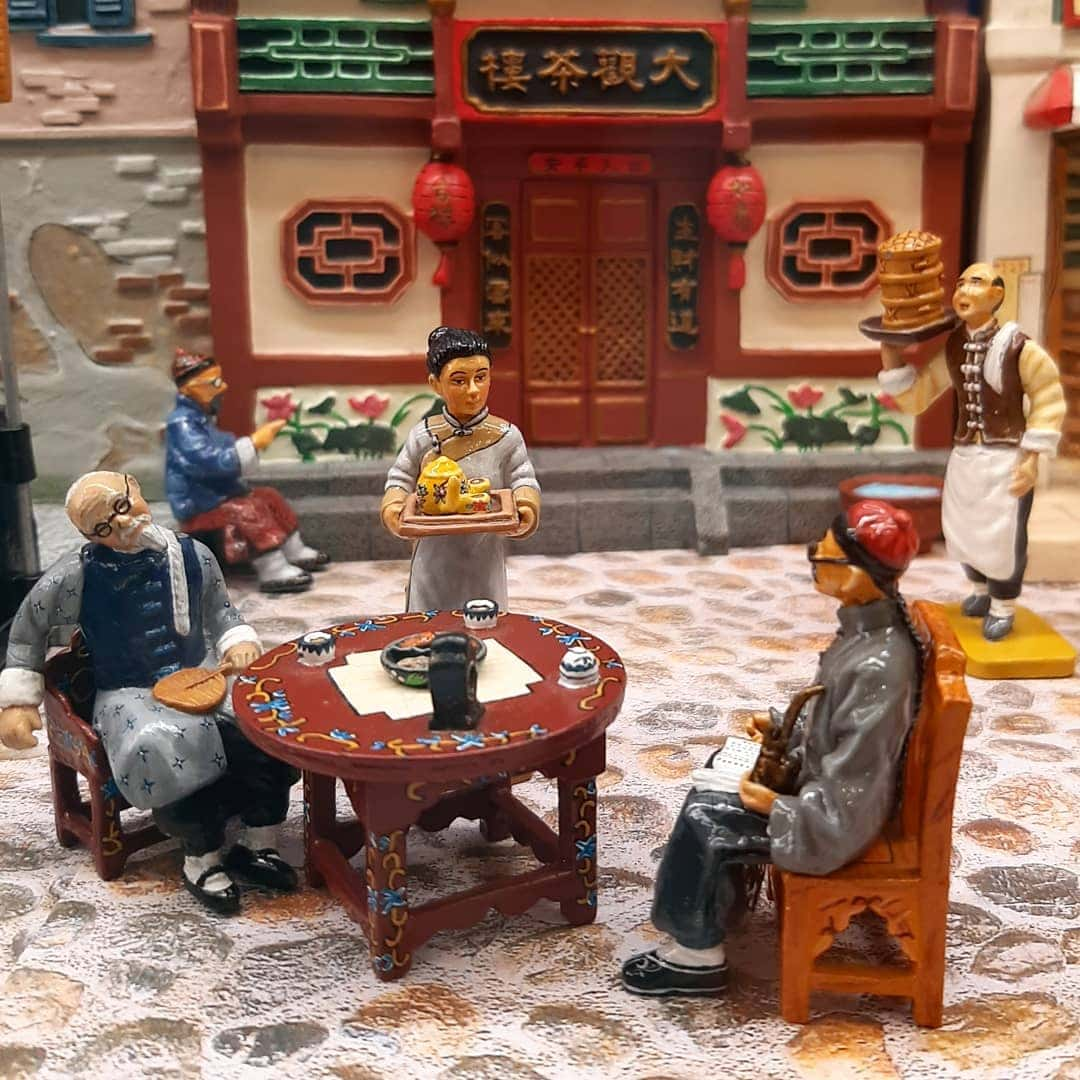 Scene depicting a normal life in Qing China, as two men sit down for tea