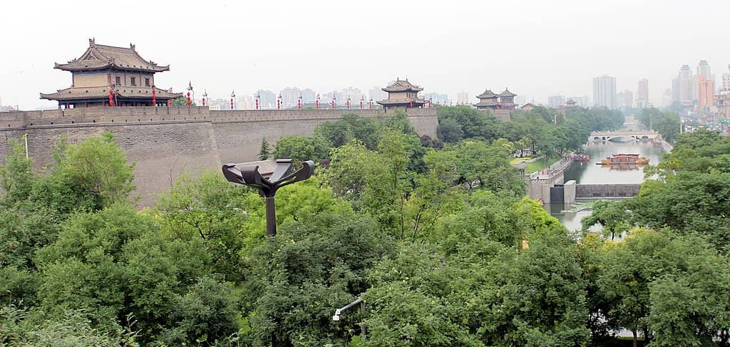 Chinese fortifications seen next to a green area and canal