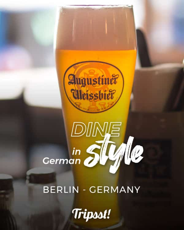 A long glass full of golden wheat beer from the Augustiner brewery