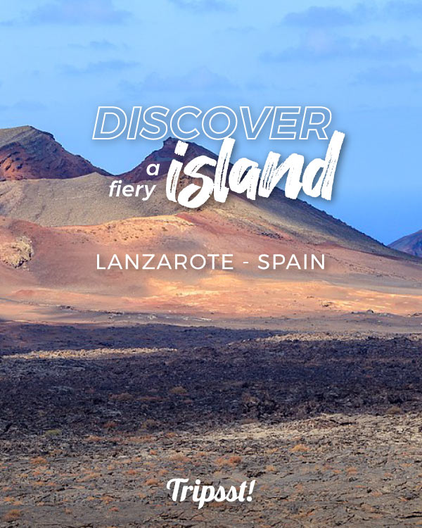 Panoramic view of a volcanic landscape, in ochre and orange tones