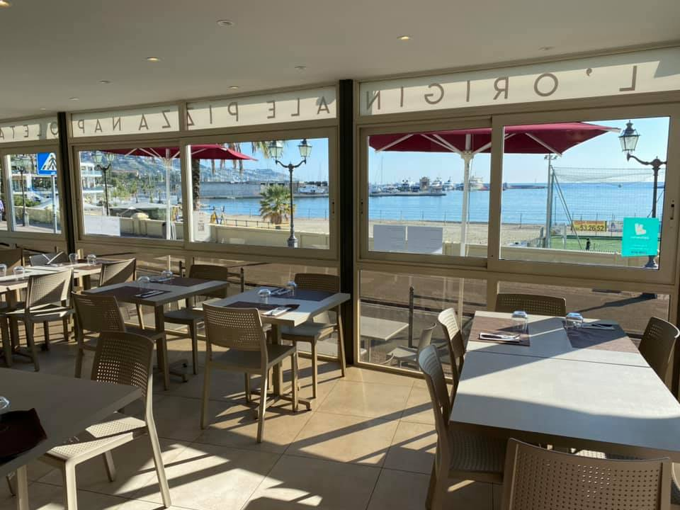 Seating area overlooks at the sea through glass windows