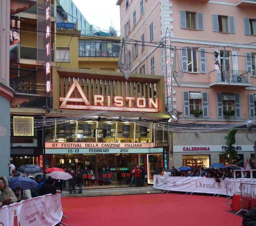 Red carpet between crowds gathered in the main entrance of a theater
