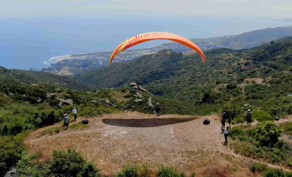 A person prepares to fly in paragliding