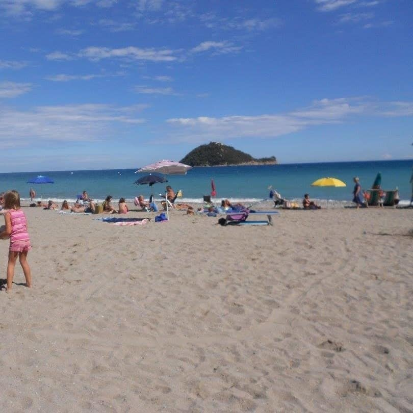 Sandy beach, with a lonely island in the background