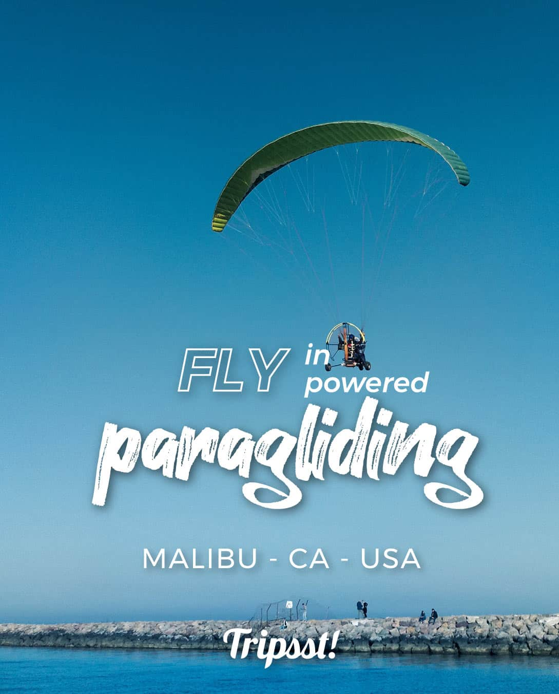 A couple in a motorized paragliding descending