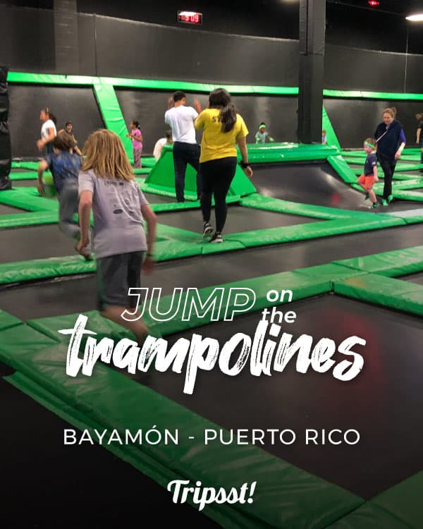 A group of boys jump on trampolines