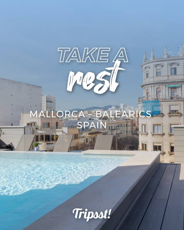 A swimming pool on the hotel terrace with a view of the center of Palma de Mallorca