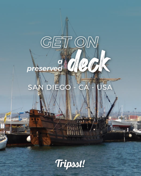 A Spanish galleon with her sails folded, on the San Diego Bay.