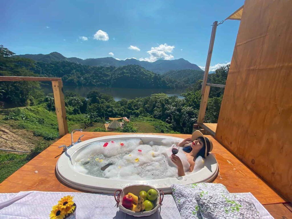 Woman treating herself to an incredible bath with amazing views at the retreat
