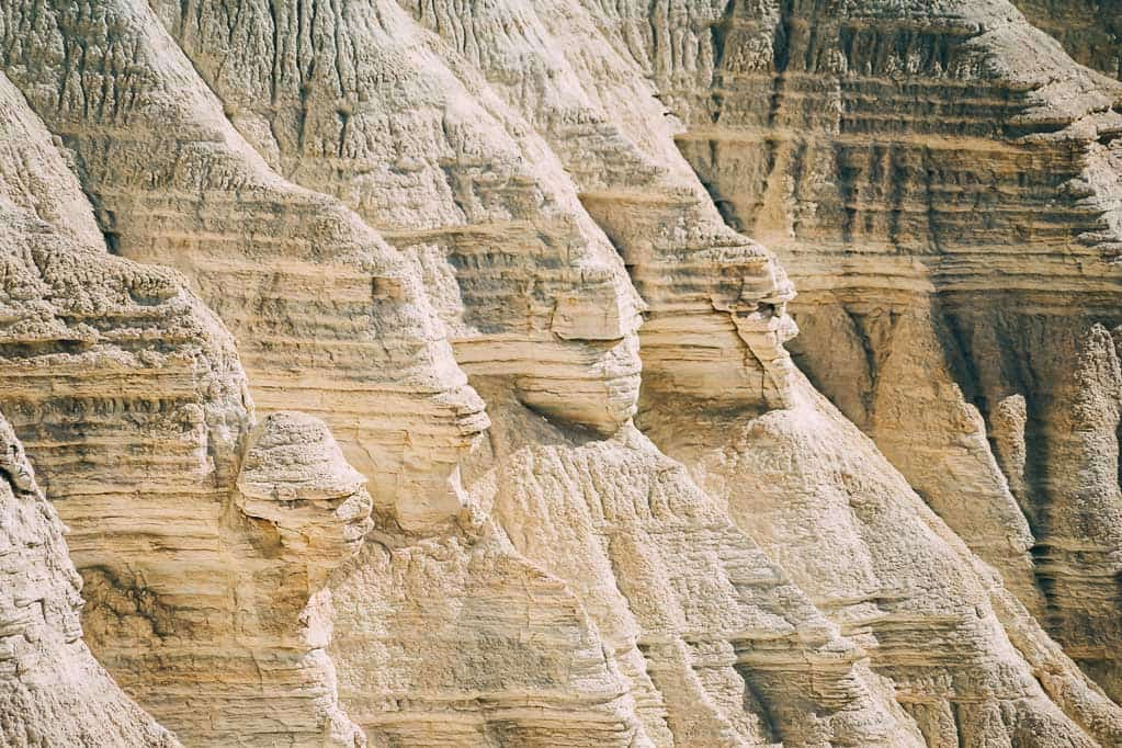 Eroded cliffs show marks from successive geological periods.